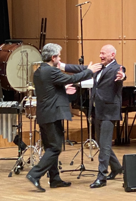 Pierre-André Valade greets Hugues Dufourt onstage after the performance of his work